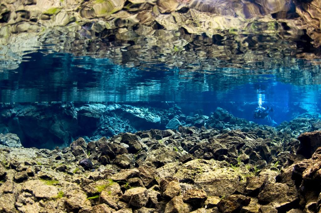 Silfra_surface_mirror_shallows_diver-1024x679