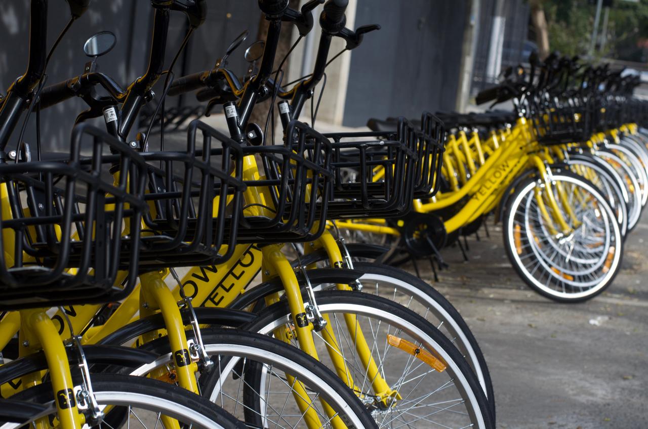 yellow bike, bike sharing, bicicleta compratilhada